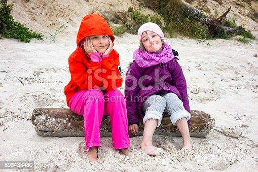 istock Girls Beach Cold Day 893433480