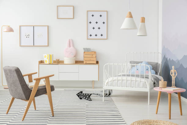 Girl's bedroom interior with mockup Pink table and grey wooden armchair in girl's bedroom interior with mockup of empty poster girl bedroom stock pictures, royalty-free photos & images