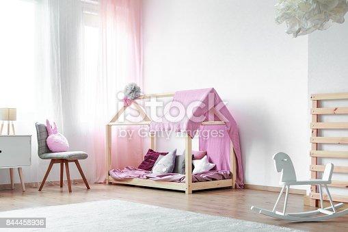 1213866189 istock photo Girls bedroom with rocking horse 844458936