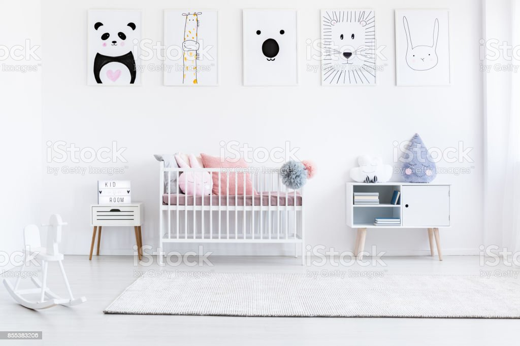 Girl's bedroom with rocking horse stock photo