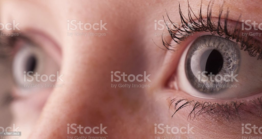Girl's Blue Eyes Close Up stock photo