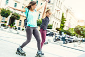 Girls bonding together and having fun with rollerskate