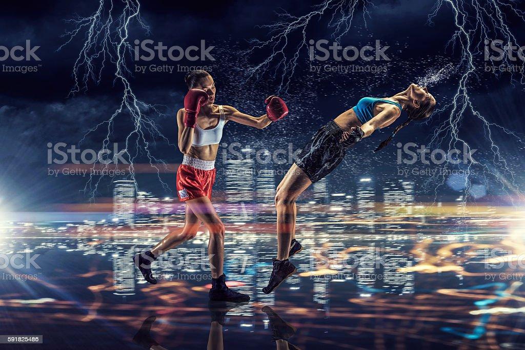 Girls boxing outdoor . Mixed media stock photo