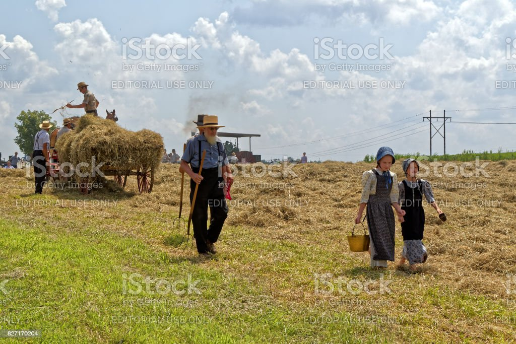 Girls Carry Water for the Hay Crew stock photo