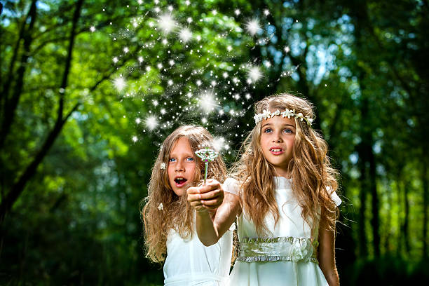 girls casting magic spells in woods. - communion stock photos and pictures