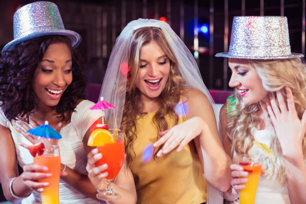Girls celebrating bachelorette party Girls celebrating bachelorette party in a club evening wear stock pictures, royalty-free photos & images