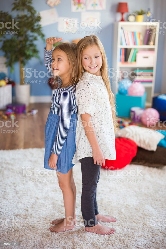Girls Checking Who Is Growing Faster Stock Photo