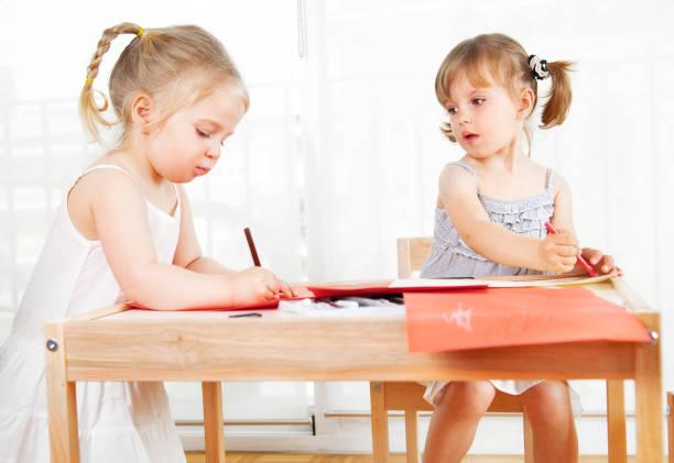 Girls colouring stock photo