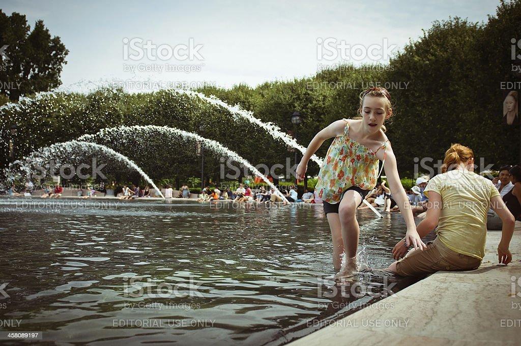 Girls Cooling Off At Sculpture Garden Fountain stock photo