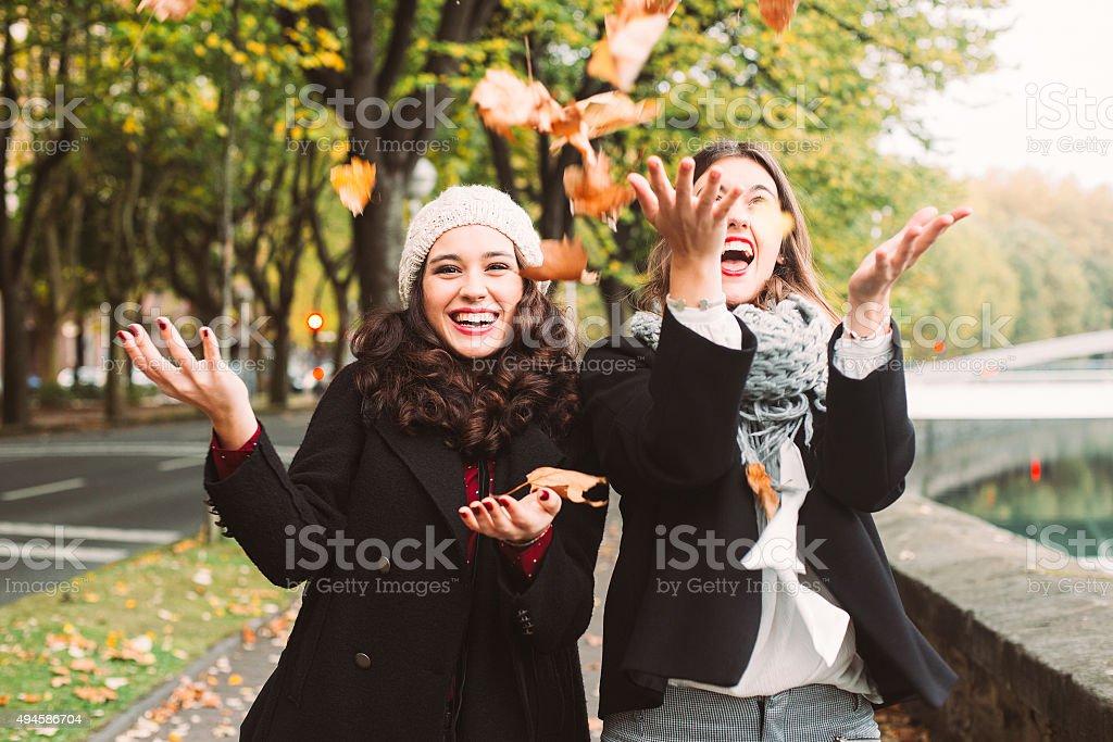 Girls crazy for autumn stock photo