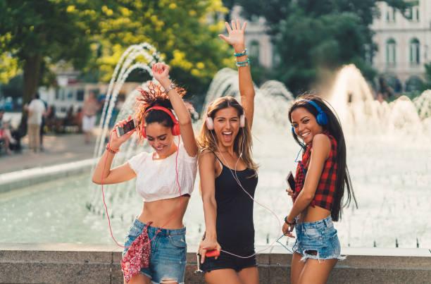 Girls dancing to music stock photo