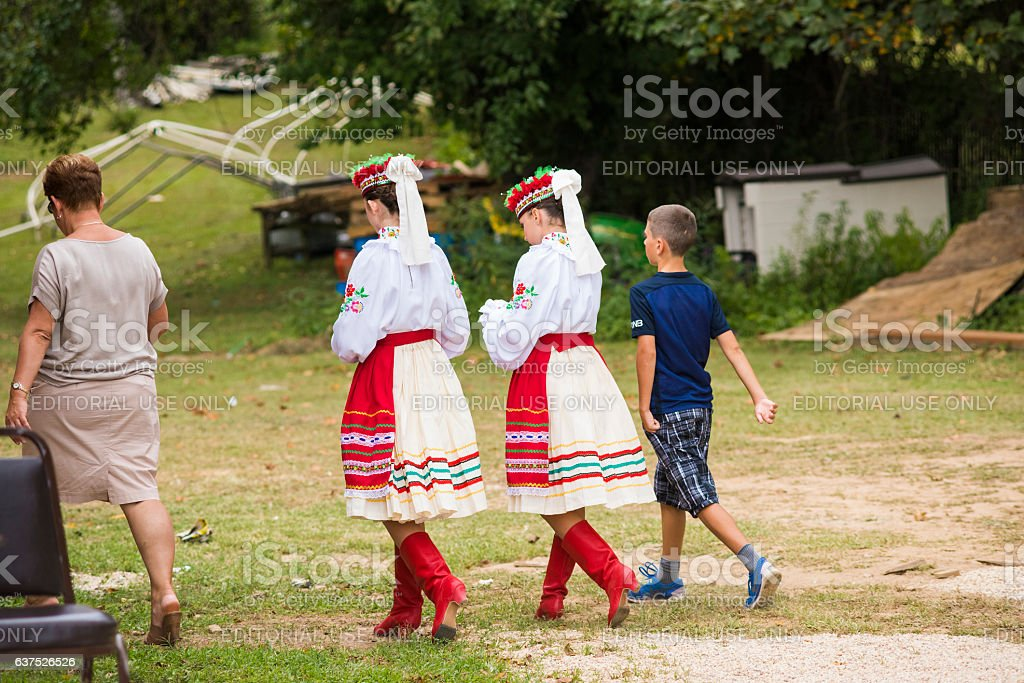 Girls dressed in traditional red Ukrainian embroidered costume clothes stock photo