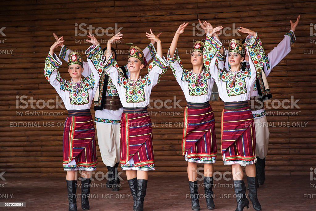 Girls dressed in traditional red Ukrainian embroidered costume stock photo