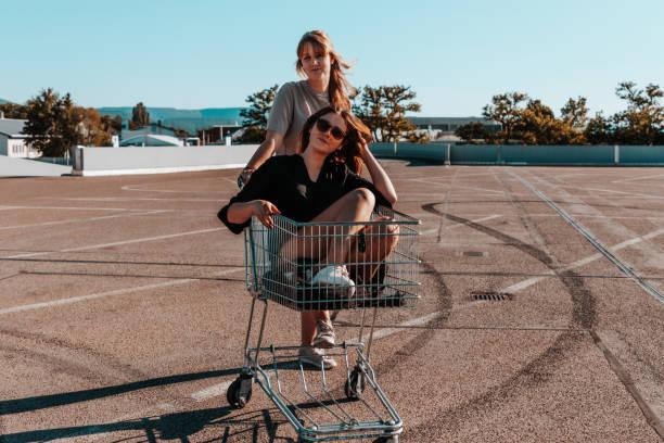 Girls drifting with Shopping Cart Having Fun stock photo
