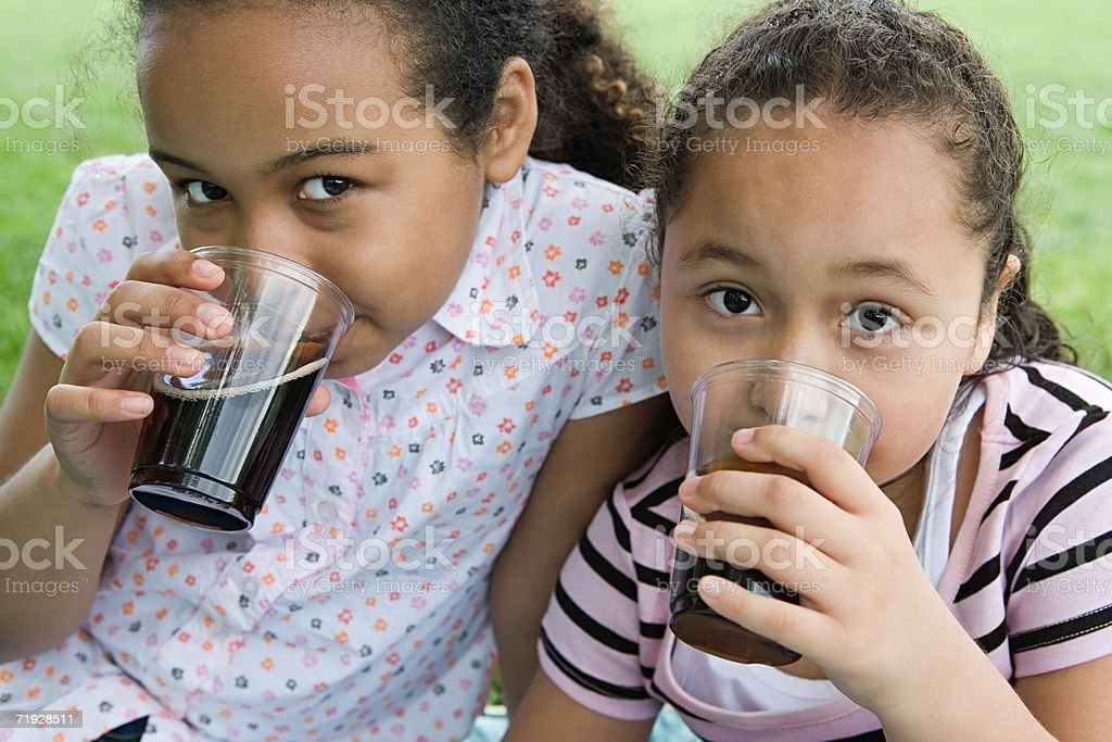 Girls drinking cola royalty-free stock photo