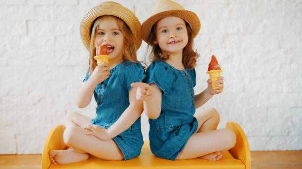 girls eat ice cream at home while waiting for vacation