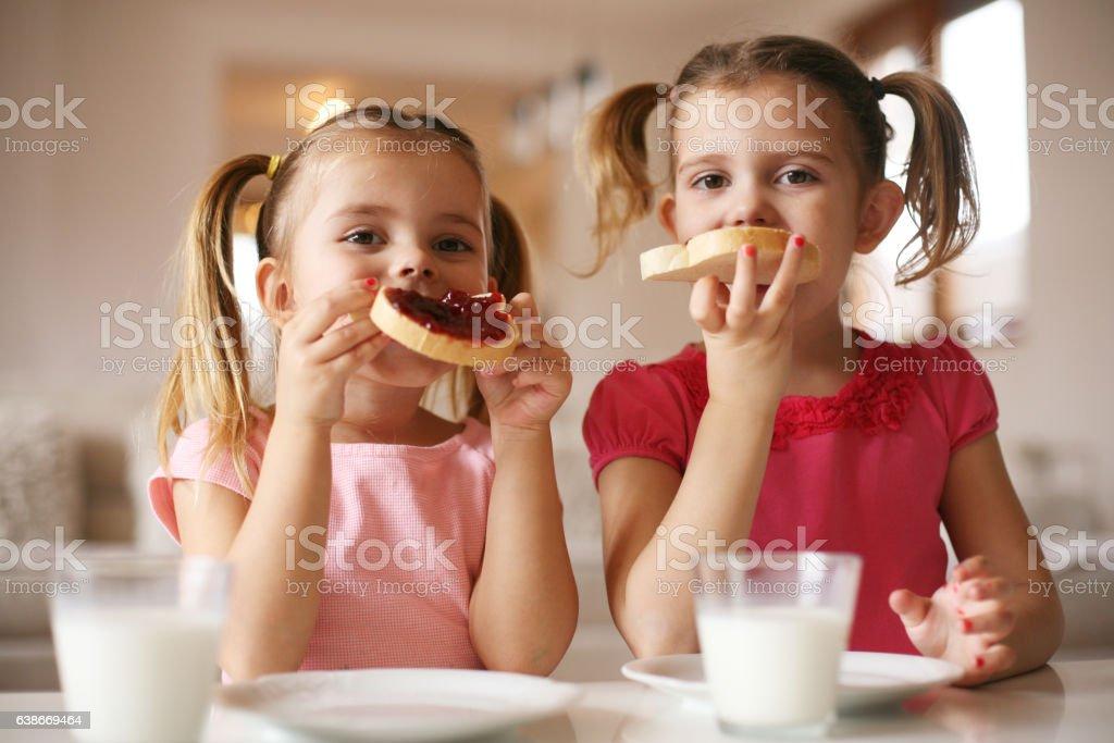 Girls eating breakfast. stock photo