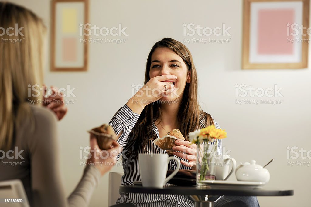 girls eating muffins royalty-free stock photo