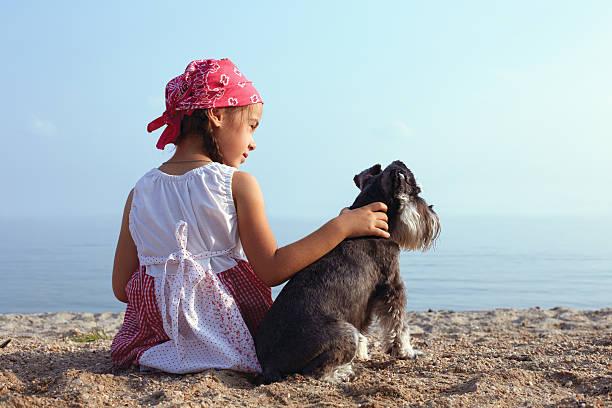 girls embracing her dog stock photo