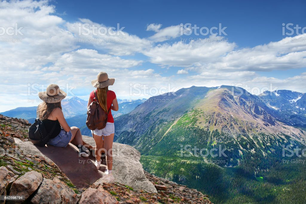 Girls enjoying  beautiful summer mountains landscape. stock photo