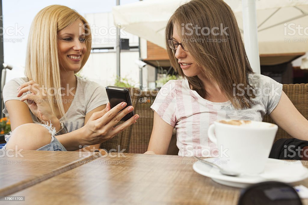 Girls enjoying sitting in cafe royalty-free stock photo