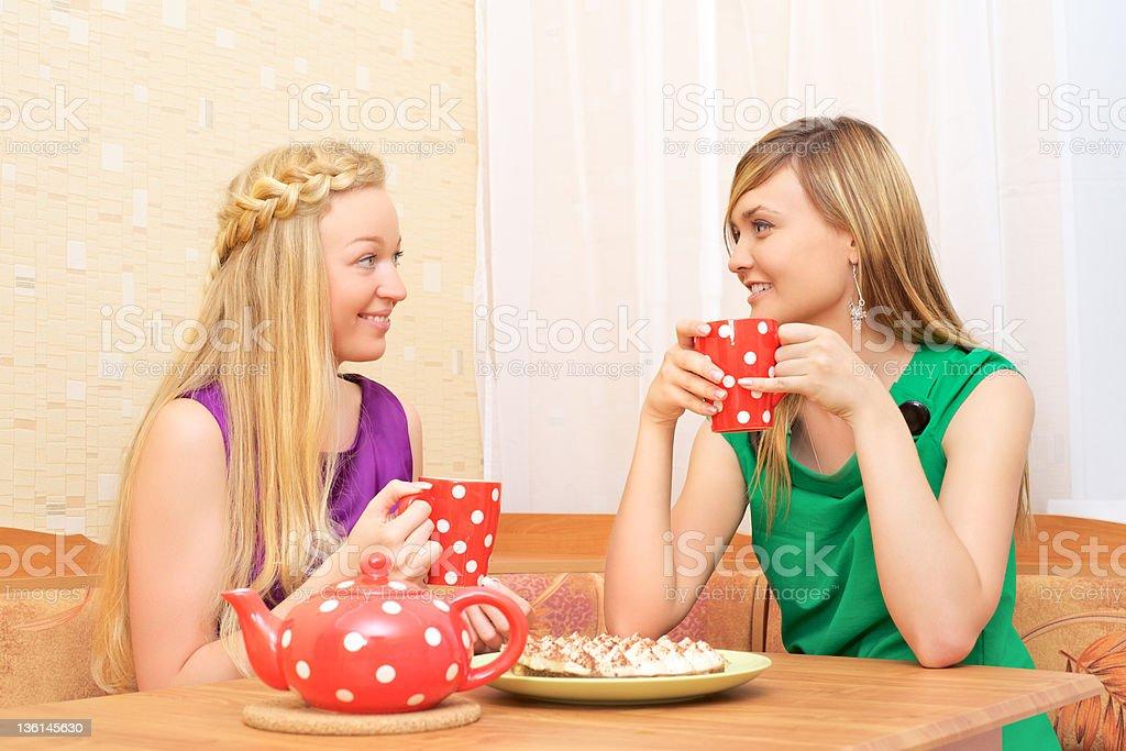 Girls Enjoying Tea royalty-free stock photo