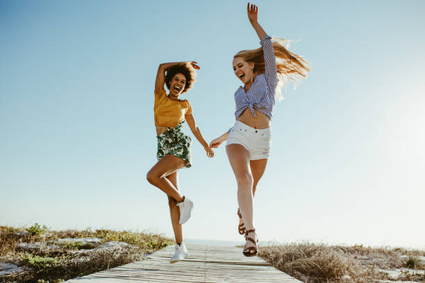 Girls enjoying their vacation stock photo