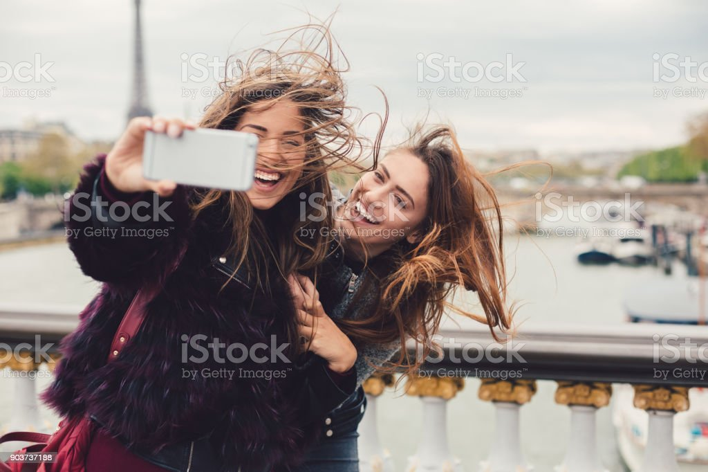 Girls enjoying vacation in Paris stock photo