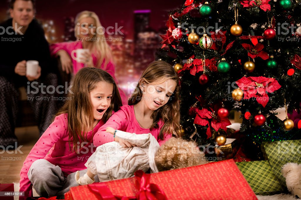 daughter family offspring 2015 6 7 years girls excitedly open christmas presents parents
