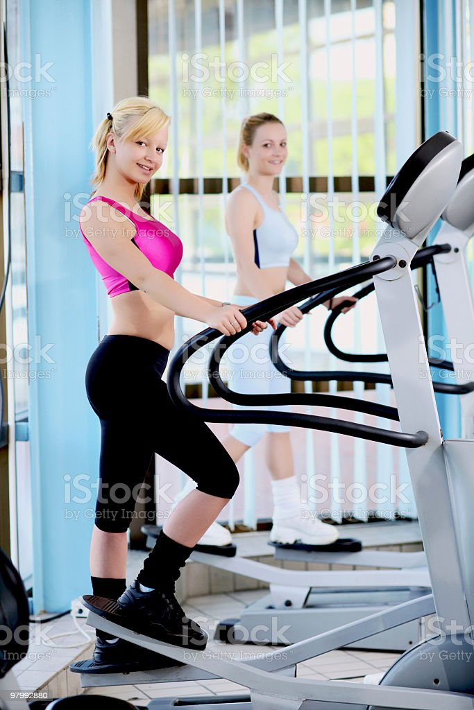 Girls exercising in fitness center. royalty-free stock photo