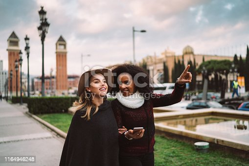 Two women sightseeing in Barcelona during the winter season