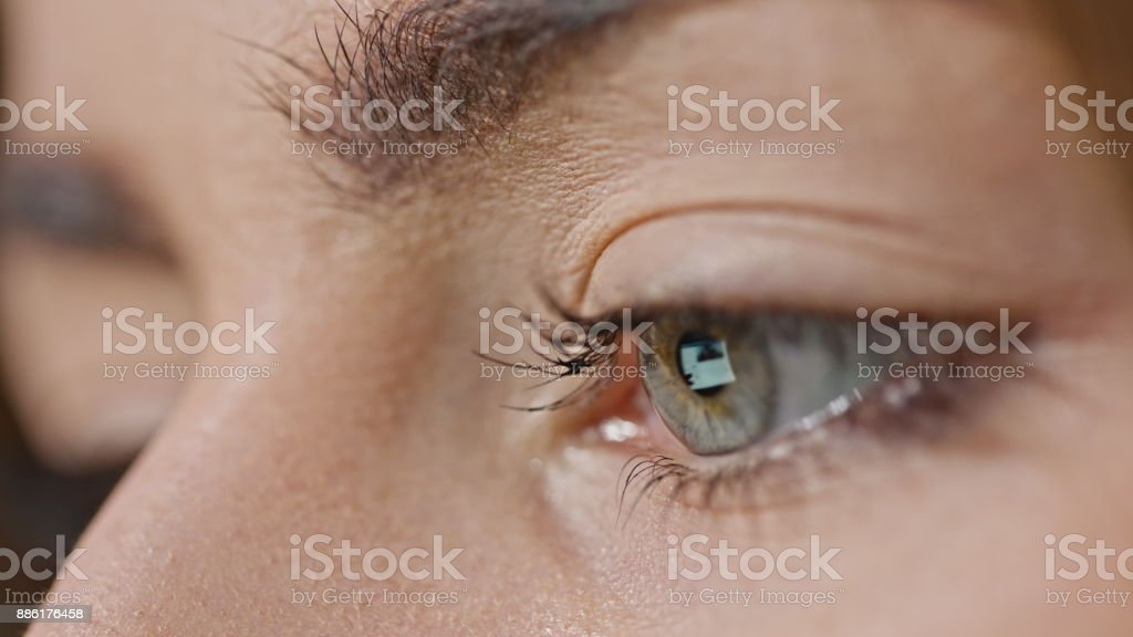 Girl's Eye with Reflection of Screen stock photo