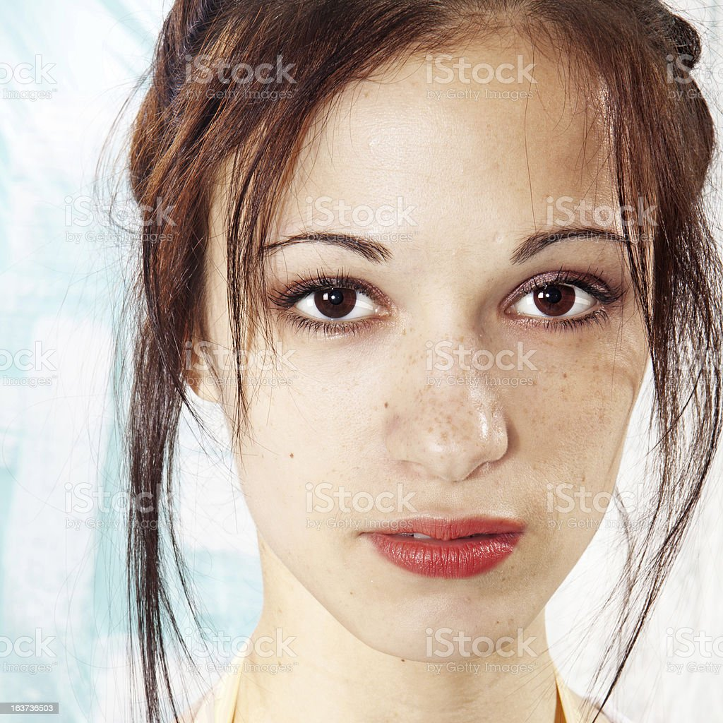 girl's face with freckles royalty-free stock photo