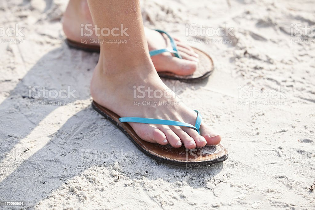 d36cda1c7cae9 Girls Feet Wearing Flipflops At Beach Stock Photo   More Pictures of ...