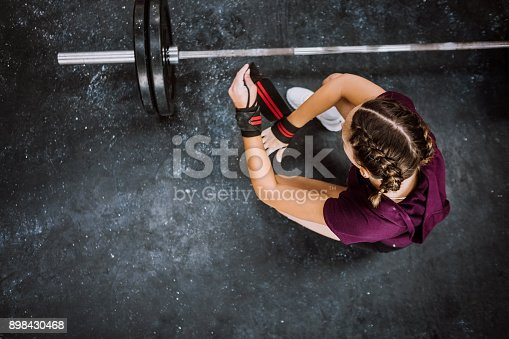 Girl Lifting Weights In Gym