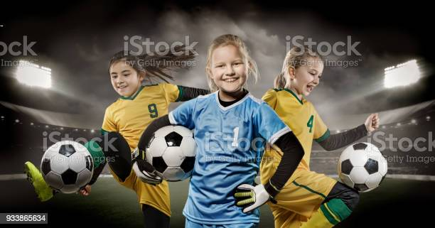 Girls football team posing for action soccer team photos in a picture id933865634?b=1&k=6&m=933865634&s=612x612&h=8kulfamto1fgia8qgyzbaw4w6c8 fqn9ezqakm tjcc=