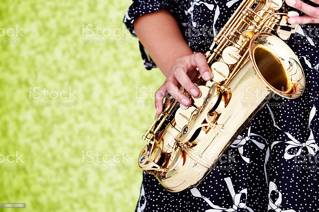 Girls get the blues, or play them! Woman playing saxophone stock photo