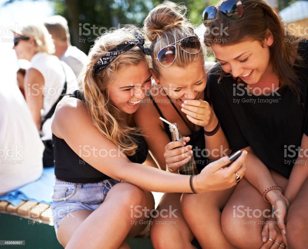 Girls getting in on the gossip stock photo