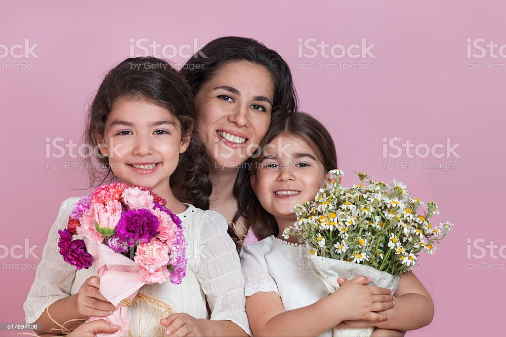 Girls giving flowers on Mothers day stock photo