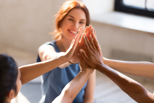 istock Girls giving high five, close up focus on hands 1092303554