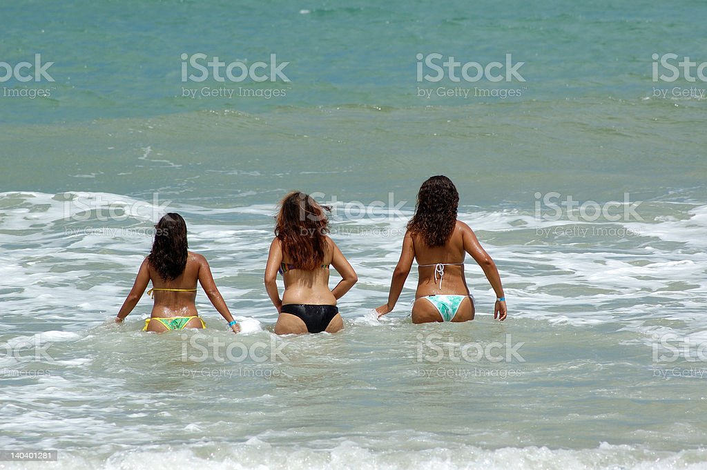 Girls going for a swim stock photo