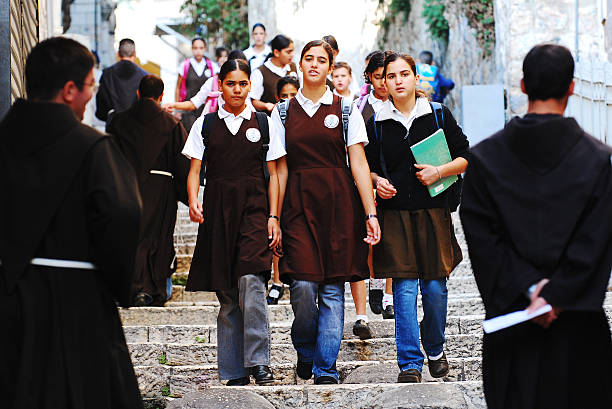 Girls going to School. Jerusalem, Israel- September 8, 2007: A group of girls on their way to School in the Muslim quarter of the Old City of Jerusalem muslim quarter stock pictures, royalty-free photos & images