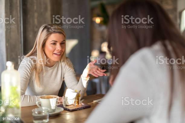 Girls gossiping at cafe restaurant picture id917922308?b=1&k=6&m=917922308&s=612x612&h=hnwyvwgwmai6ghu2u9alqmi ohv fxpe9od3chkln8o=