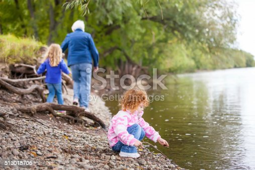 istock Girls & Grandma on Riverbank 513018705