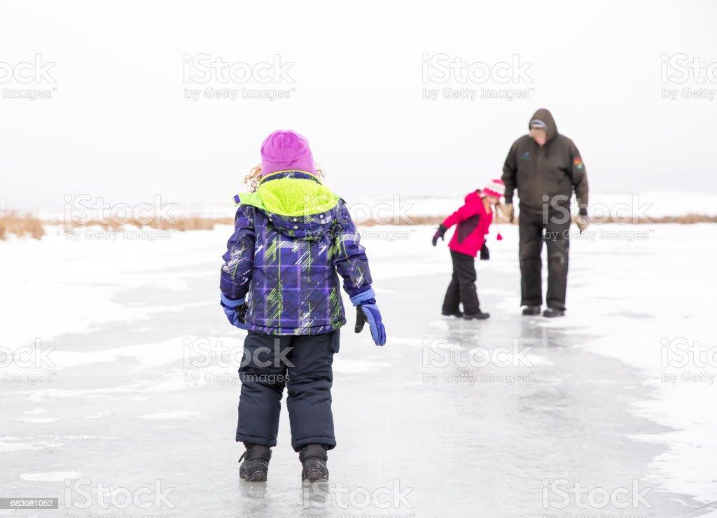 Girls & Grandpa Playing on Ice in Winter foto de stock royalty-free