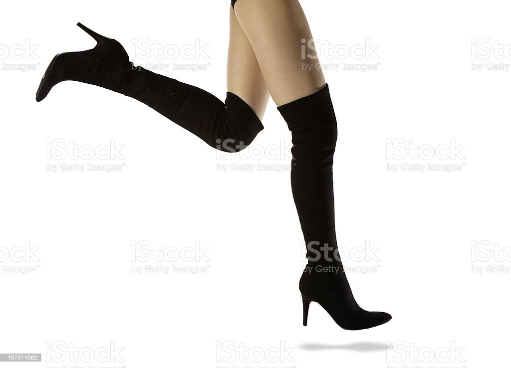 Girl's Great Legs, Amazing Long Tall Black Leather Spike Boots stock photo