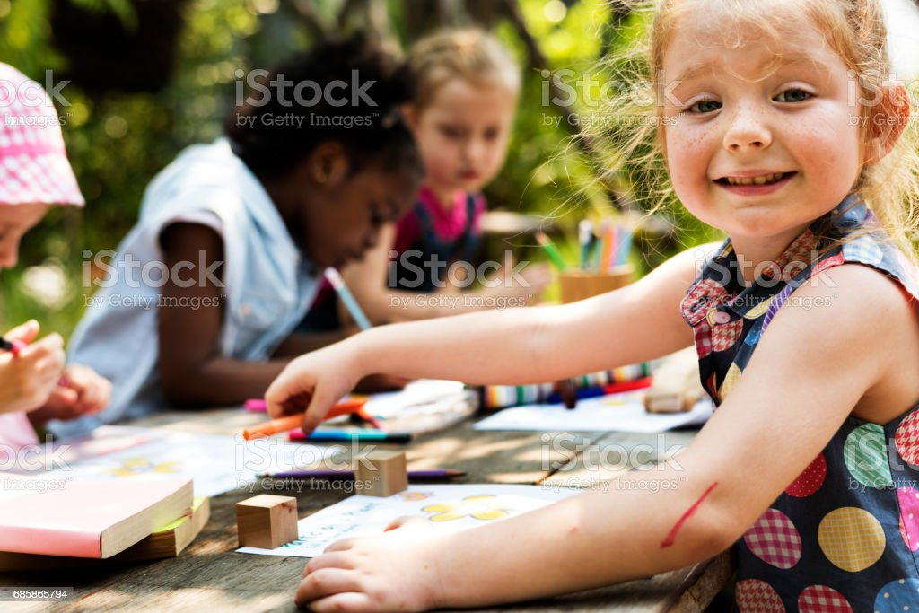 Girls group children drawing outdoors stock photo