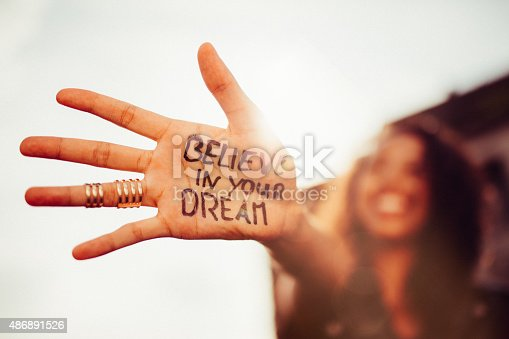 Closeup of a teenage girl's hand with the phrase