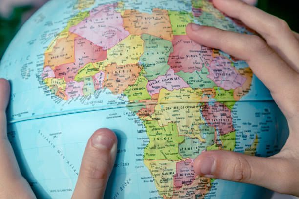 Girls Hands And The Globe Globe in the Girls Hands while she looking for her travel desitation at Africa continent. country geographic area stock pictures, royalty-free photos & images