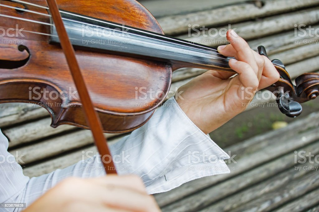 Girl's hands on a violin strings stock photo
